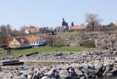Utzons vandtårn set fra kysten/Vigehavn